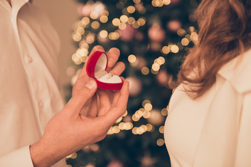 Close up of young  man making proposal of marriage on Christmas Fototapete