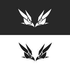Two Hawk or Falcon Head Silhouette Logo