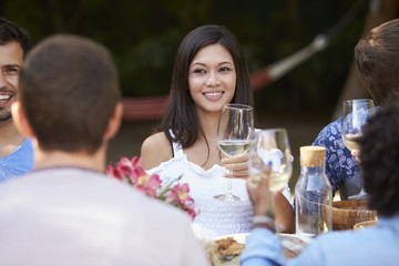 Young Woman Enjoying Outdoor Backyard Party With Friends
