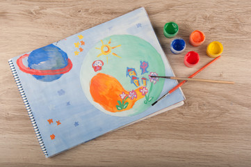 Painting of space drawn by gouache lay on table