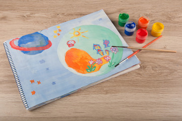 gouache painting of space drawn on paper lay on table