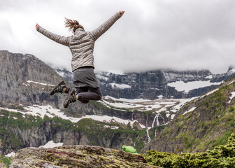 Woman in Warm Clothes Jumps in Excitement
