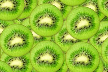 Many slices of kiwi fruit, background