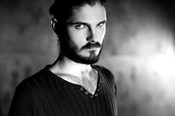 black and white portrait of young bearded gothic hipster man