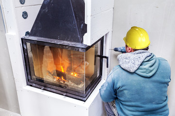Fireplace installing. Fireplace made from Calcium Silicate Fire Protective Board