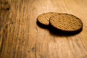 Cup and biscuits on a wooden background. Close up picture. Natural daylight.