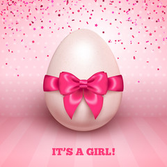 It's a girl baby shower with pink ribbon and egg
