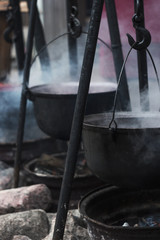 hot cast iron pot with soup