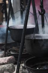 hot cast iron pot with soup