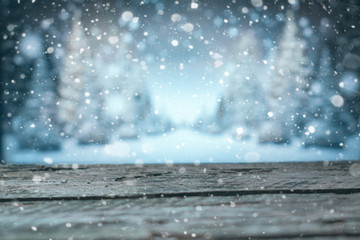 Wooden boards on the winter blur background