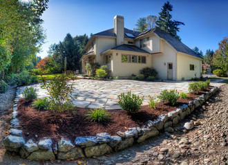 Fotobehang - Suburban home and back garden on a sunny autumn afternoon with new stone patio
