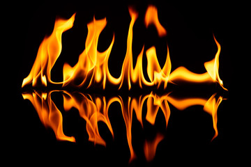 The fire on black glass with a reflection