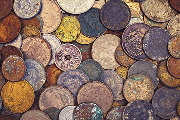 Vintage oxidised coins of different nationalities from different periods, top view.
