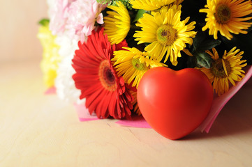 The  bouquet of flowers and red heart greeting card for Valentine's day