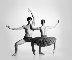 Young ballet dancers on a white background