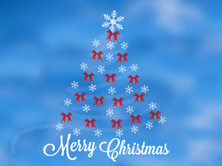 Christmas tree with flakes and red ribbons greeting card on blue cloudy sky