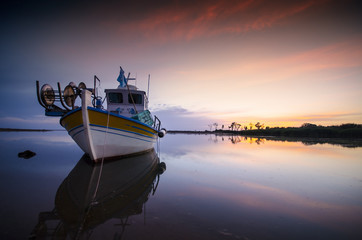 The fishing boat at sunset Greece