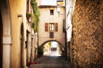 narrow street in medieval old town on Lake Garda in Italy