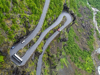 Overhead view of coach going round hairpin bend on narrow Trollstigen mountain road in Norway