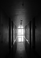 Black and white hotel hallway