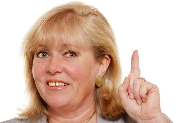 Mature woman pointing her finger up -  we're number one