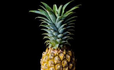 Half pineapple isolated on black.