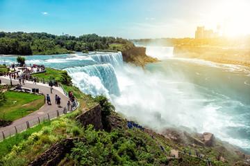 American side of Niagara falls, NY, USA. Tourists enjoying beautiful view to Niagara Falls during hot sunny summer day..