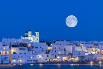 Local church of Naoussa village at Paros island in Greece against the full moon.  Wall mural