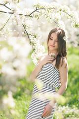 Outdoor Portrait of a Beautiful Brunette Woman in Color dress am
