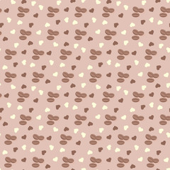 Seamless background with coffee grains and hearts