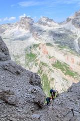 climbers at via ferrata, dolomites, Italy