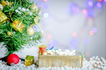 Gift boxes and ornaments in Merry Christmas and Happy New Year concept  with bokeh background, can be use for make a greeting cards.