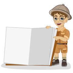 cute little explorer boy in a safari outfit showing giant book open