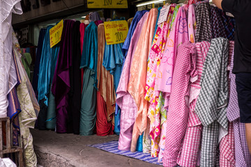 Colorful textile at market. For shopping, industry, sale