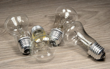 Electric light bulbs on wood background.