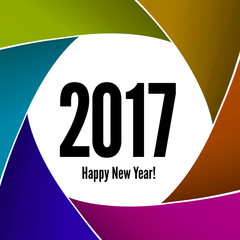 Happy New Year 2017 on a background of the camera lens
