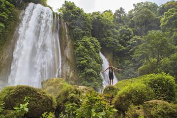 Young man enjoying nature at Cikaso Waterfall