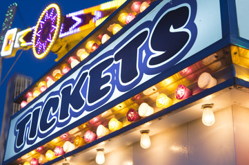 carnival ticket booth marquee with lights at night