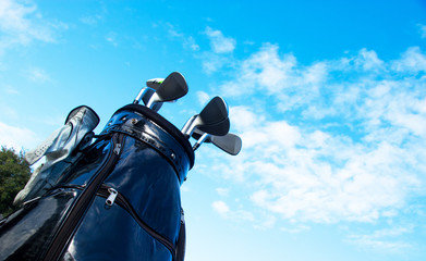 Golf club in bag with sky.