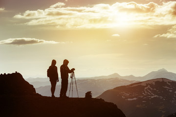 Couple photographers mountain top travel