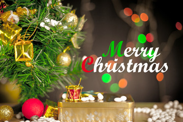 Merry Christmas and Happy New Year text with gift boxes and ornaments in white bokeh background