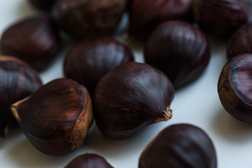 Chestnut fruits on light background selective focus