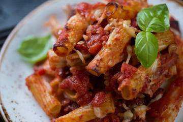 Closeup of cooked italian ziti on a glass plate, selective focus