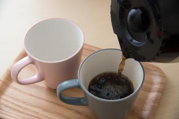 pair of mug and coffee pot