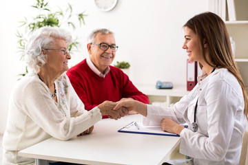 Senior couple on consultation with a doctor, close up