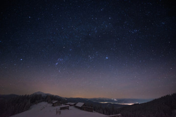 The Milky Way over the winter mountains landscape