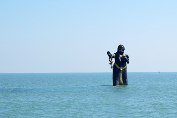 Giant statue in the sea