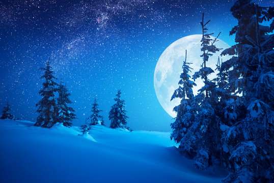 Full moon rising above the winter valley