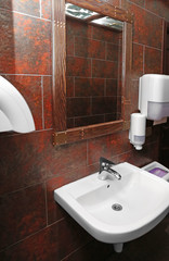 Interior of lavatory in modern cafe
