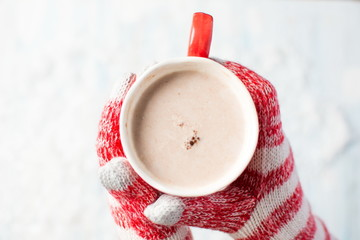 Foto op Plexiglas Chocolade female hands in gloves holding hot chocolate